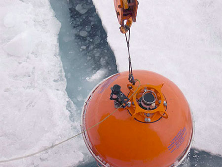 Top flotation sphere being recovered using the ship's crane.