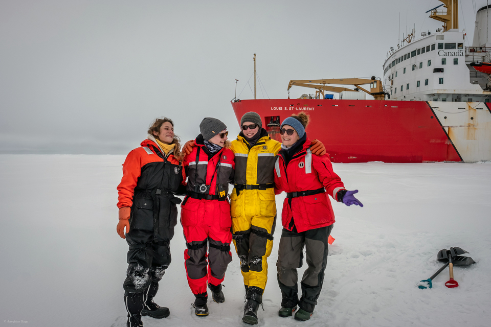 Happy ice coring team after a successful ice station day! From left to right: Aurélie Labarre, Helen Gemmrich, Kristina Brown, and Josephine Rapp. (Photo: Chris Clarke)