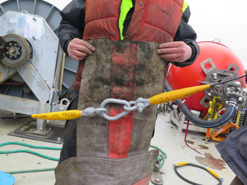 wrapping hardware while deploying moorings