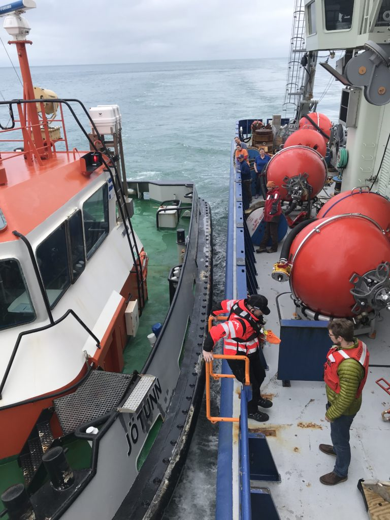 pilot jumps aboard R/V Armstrong on way into port