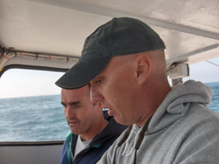 Eric Hessell (foreground; UCSB divemaster) and Chris Reddy (WHOI) aboard the R/V Connell along the Santa Barbara coastline