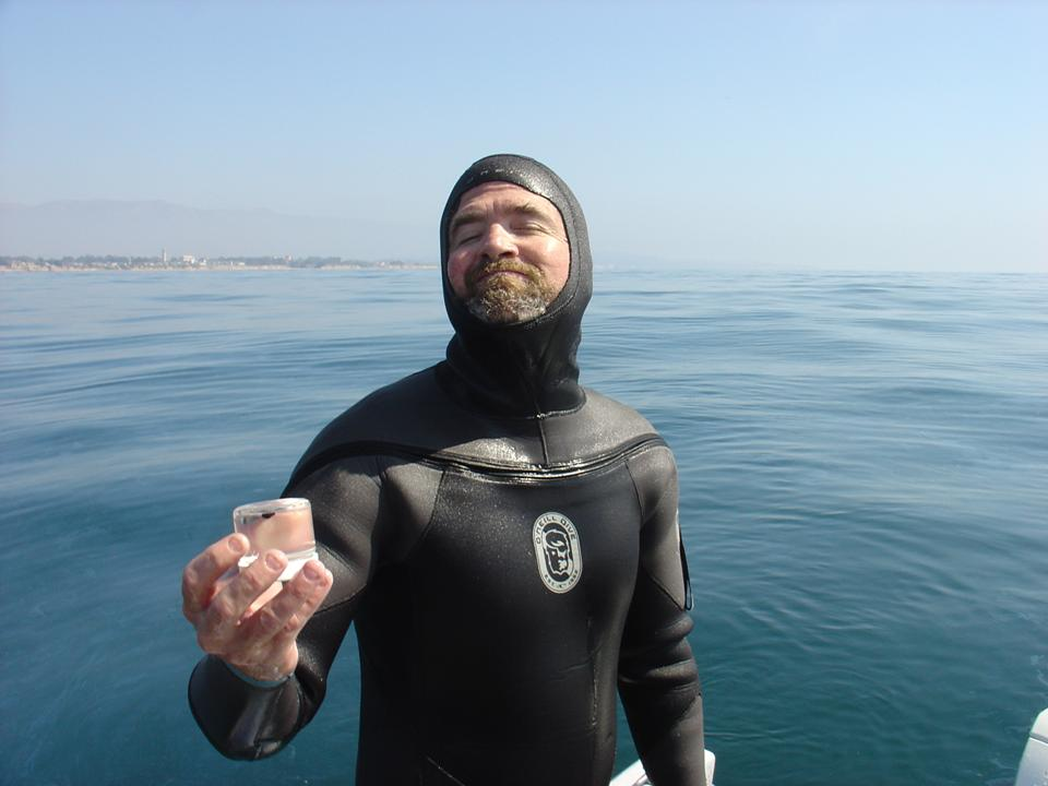 George Wardlaw (UCSB) aboard the R/V Connell and holding a recently-collected oil droplet at the Santa Barbara oil seeps
