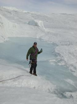 Collecting water samples from a supraglacial lake atop the western Greenland Ice Sheet. (Ben Gready)