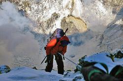 Man climbing up ice using instruments