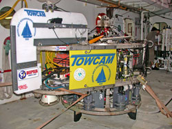 The second frame (TowCam#2; ~1500 lb air-weight, ~750 lb. water-weight fully configured) is available for use by any investigator requesting it and can be deployed from most ships in the UNOLS fleet that have a CTD winch and 0.322? conducting cable system.