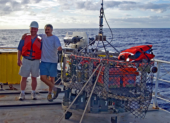 WHOI oceanographers Dan Fornari (right) and Tim Shank pause on deck with TowCam during a 2004 expedition to Lau Basin in the South Pacific. (Photo courtesy Dan Fornari, WHOI)