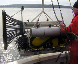 Ben Allen (WHOI) guides the REMUS Docking Station