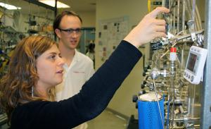 Chiara Sanitelli, a visiting scientist from the Institute of Biophysics in Pisa, Italy, works on a vacuum line