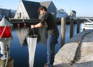 Rene Boiteau, a Joint Program student in the Repeta Lab, collects plankton for an outreach event