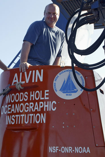 Bilogist Tim Shank climbing in submersible Alvin