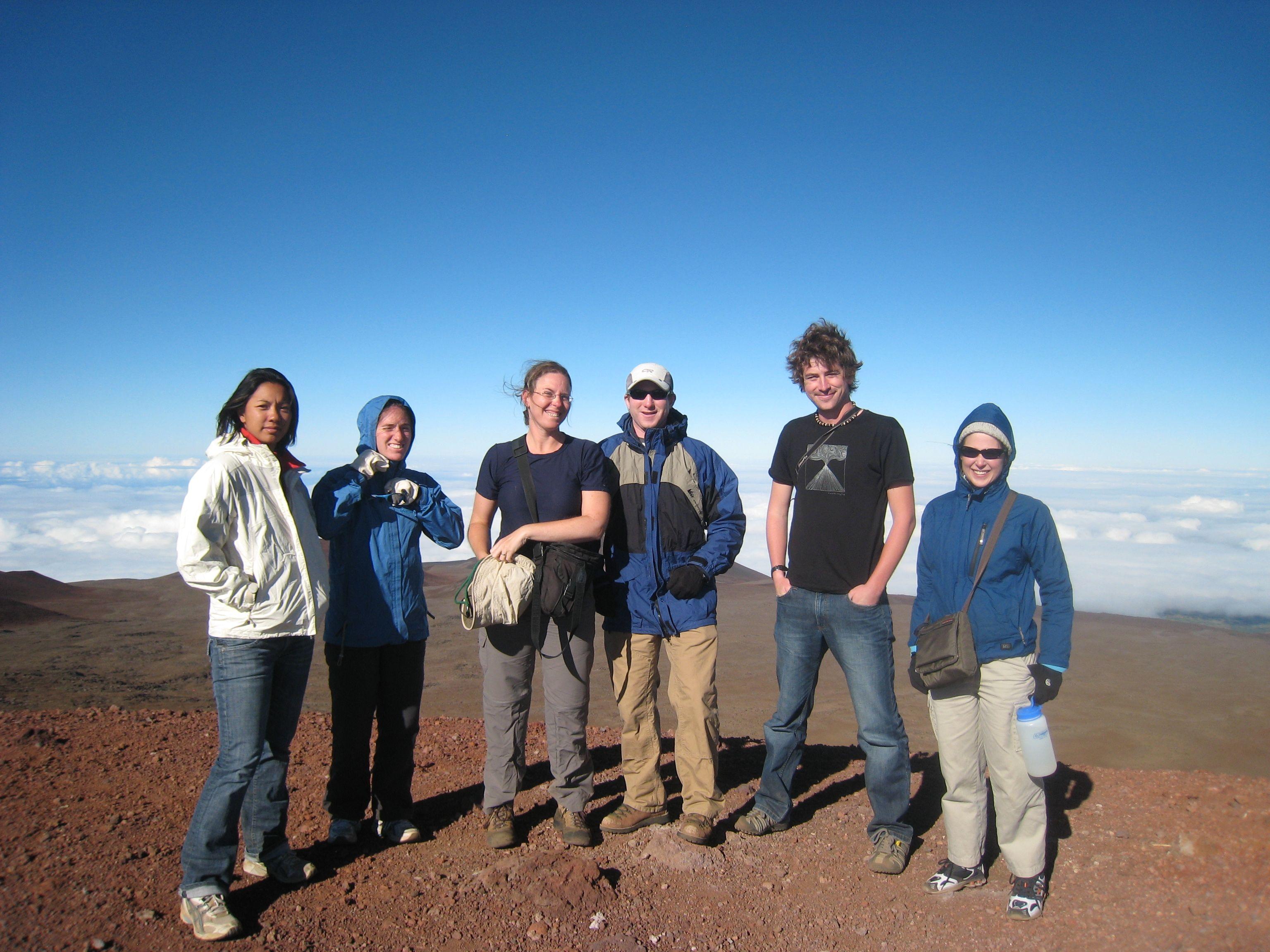 Field team on top of Mauna Kea Volcano during field work, Summer 2009 [from left: Sam Nakata (WHOI), Hannah Dietterich (U. Oregon), Einat Lev (LDEO, U. Columbia), Adam Soule (WHOI), Jess Robertson (ANU), Natalia Deligne (U. Oregon)] (K. Cashman, U. Oregon).